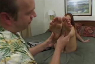 Nasty redhead spreads beautiful feet and clit from Foot Fetish Porno